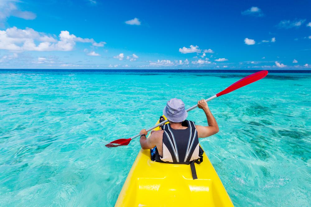 man kayaking in the ocean