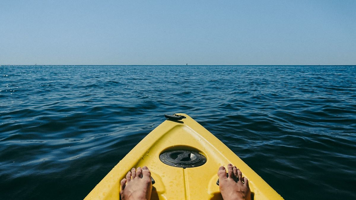 person kayaking on the ocean